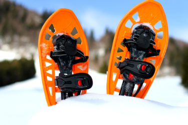 snowshoes for walking on the white snow on the mountain in cold winter